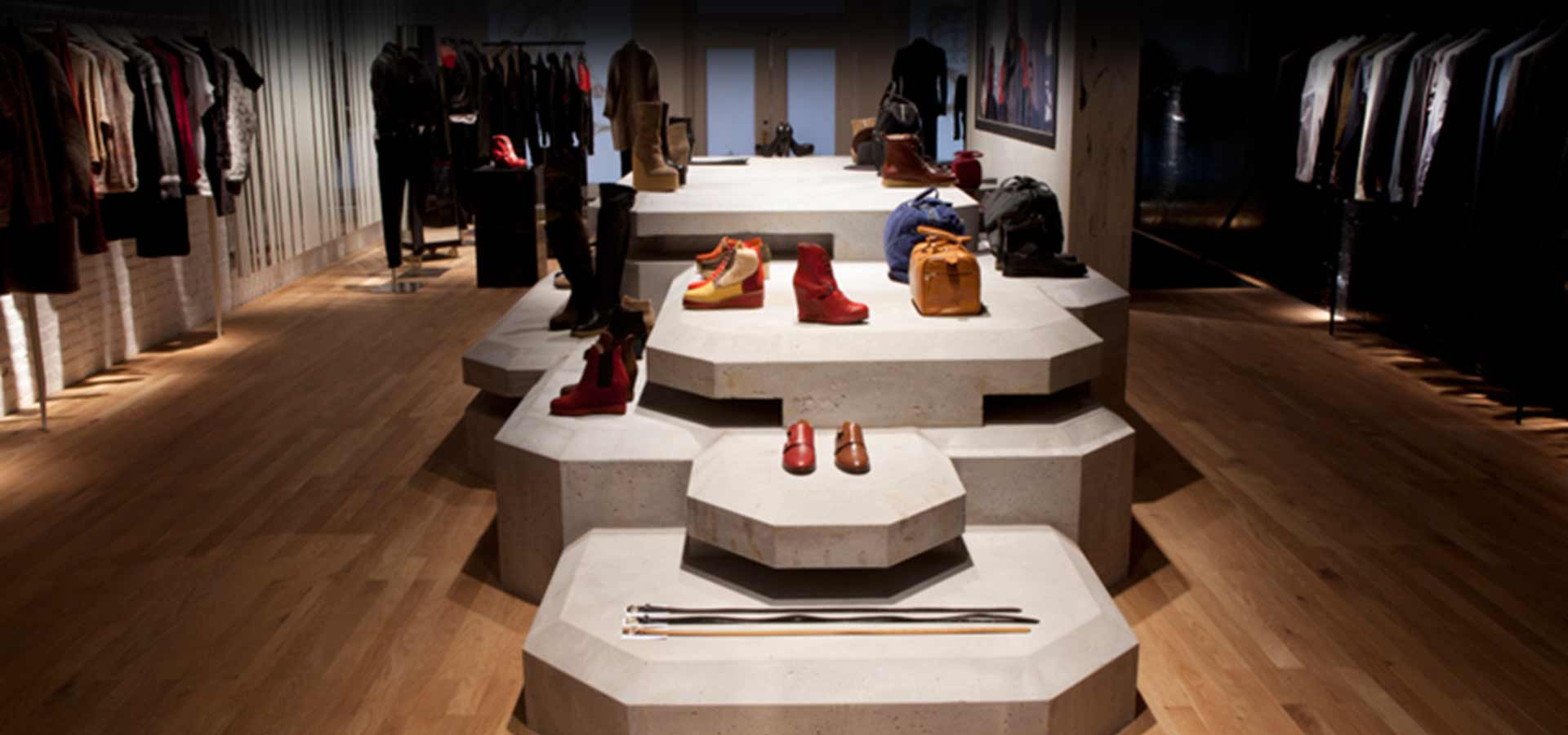 """retail design firms nyc create a modern, moody space for """"Surface to Air"""" (back view)"""