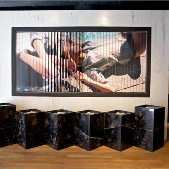 Retail design firm NYC created a rotating billboard inside store at Surface to Air